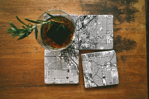 A set of four customized marble coasters printed with detailed maps of any location for newlywed gifts