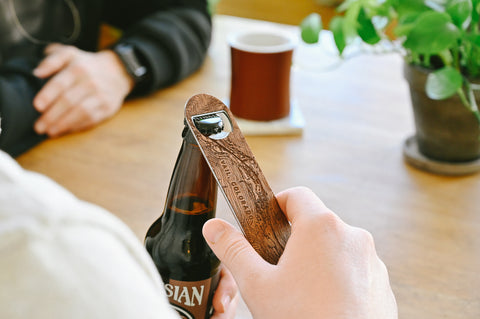 A customized bottle opener etched with a detailed map of any location for groomsmen gifts