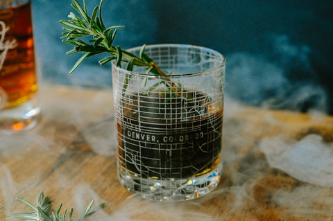 A customized rocks glass etched 360 degrees with detailed maps of any location for groomsmen gifts