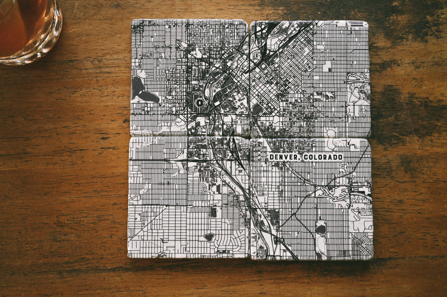 "Set of four 4"" x 4"" marble coasters with a printed map of Denver, Colorado and a cork backer"
