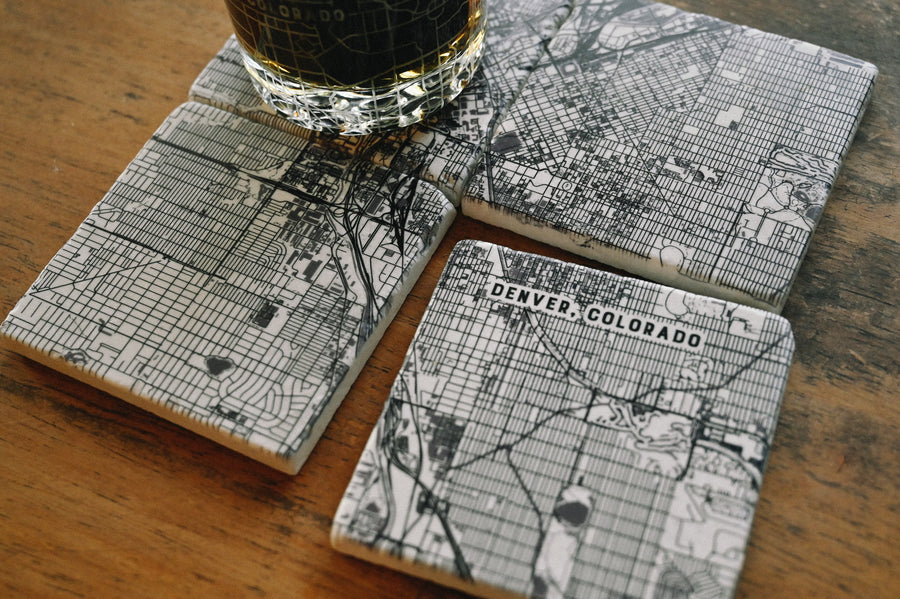 "Set of four 4"" x 4"" marble coasters with a printed map of Breckenridge, Colorado and a cork backer"
