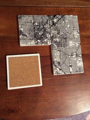 "Set of four 4"" x 4"" marble coasters with a printed map of Boulder, Colorado and a cork backer"