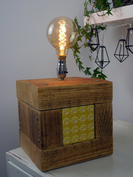 Scaffolding plank lamp with tile insert.
