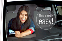Young woman makes a windshield sticker easily removable with sticker shield.