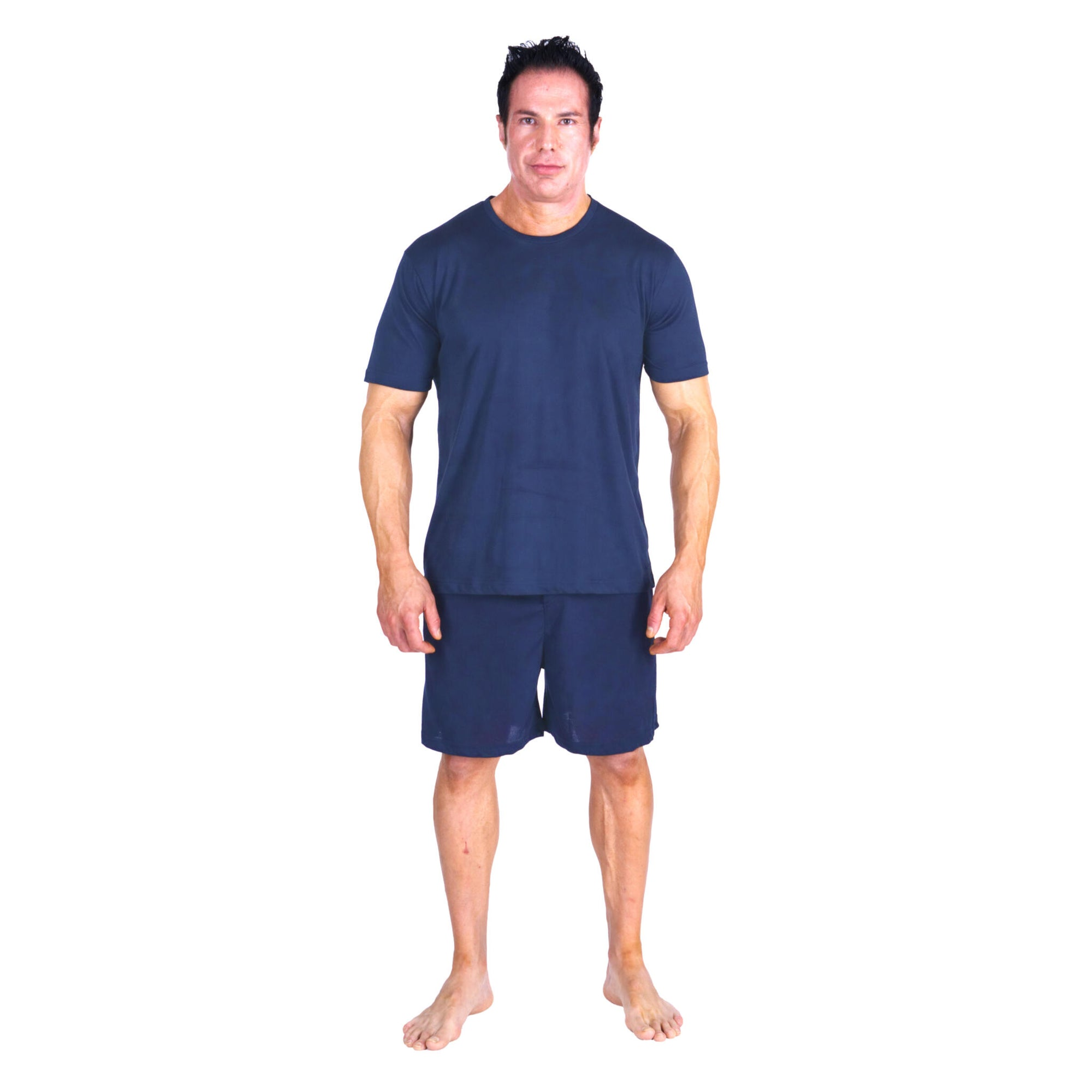 A man standing wearing moisture wicking sleepwear & cooling pajamas