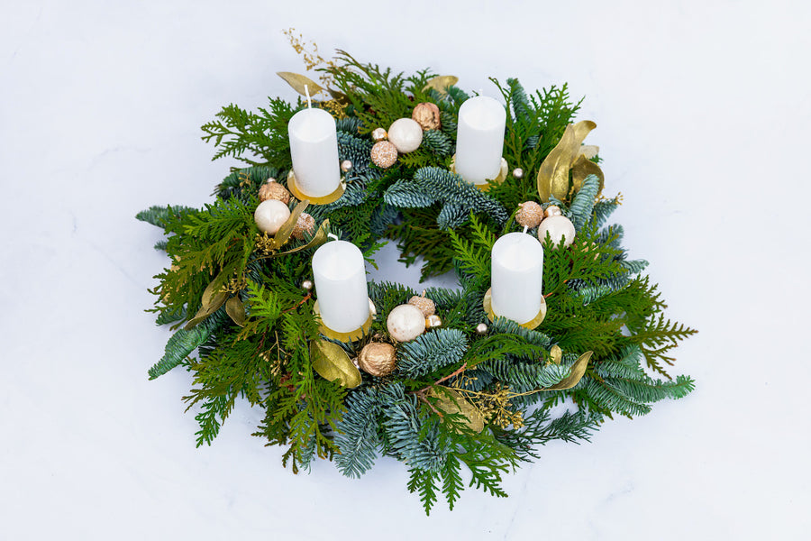 Christmas fir wreath in Gold color with white candles