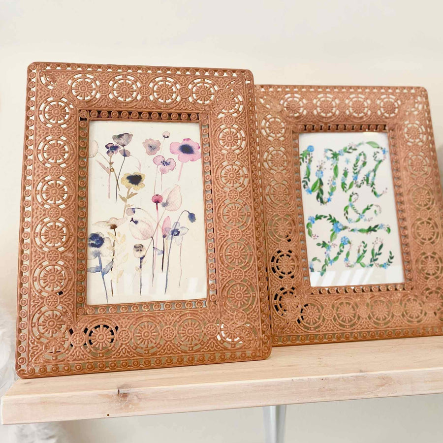 Picture frame with copper flower ornaments