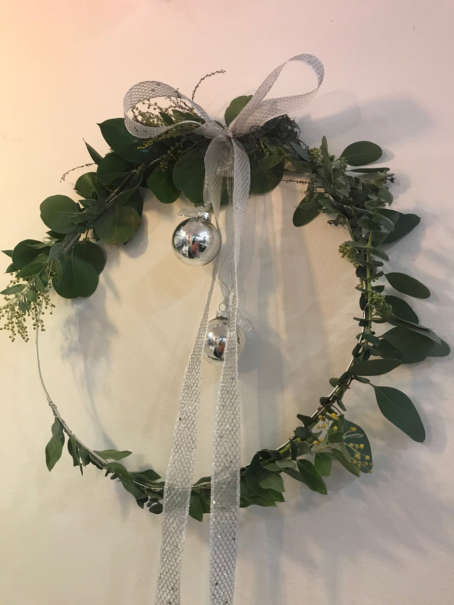 Christmas fir wreath on string in Silver color