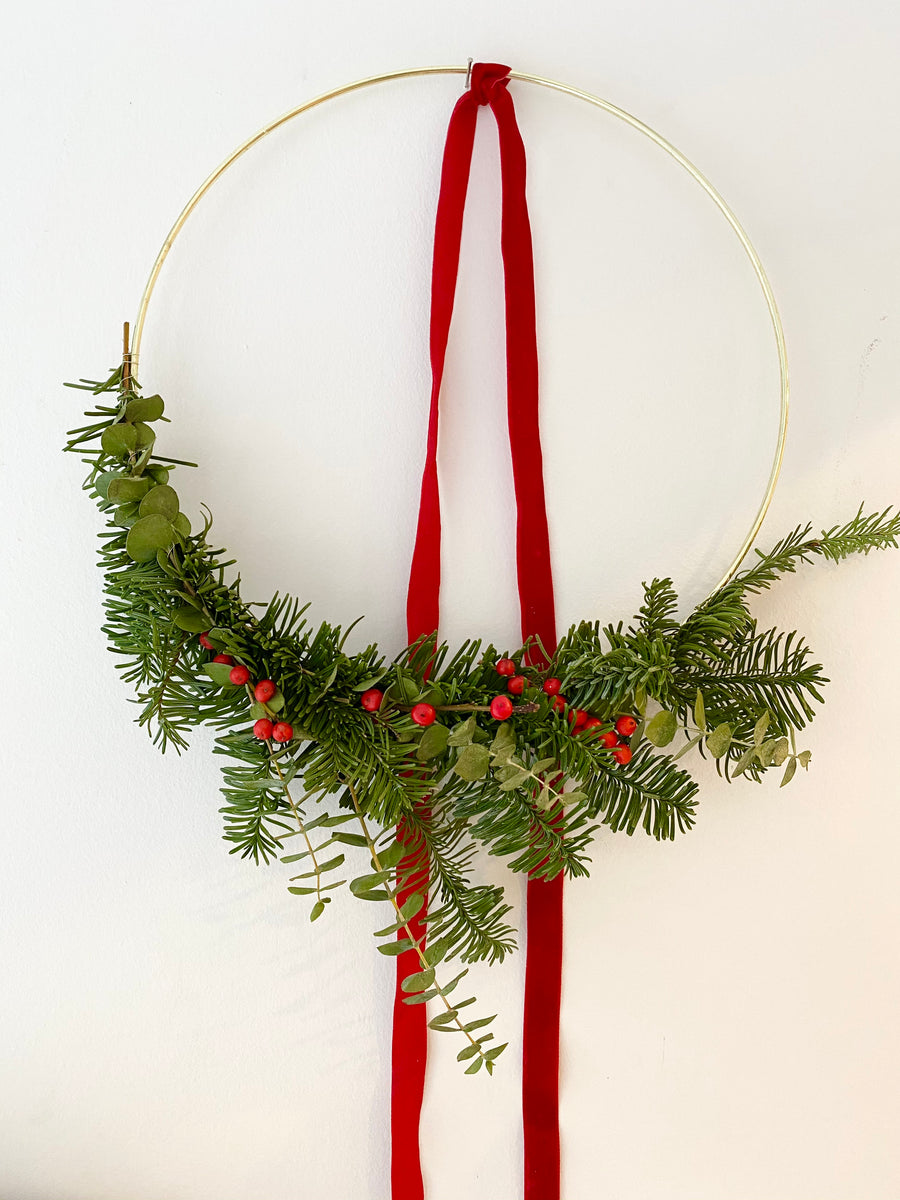 Christmas fir wreath on string in Red color