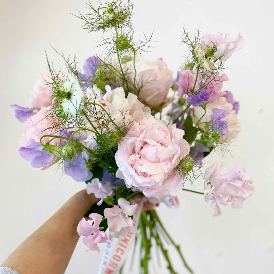 Peonies with sweet pea