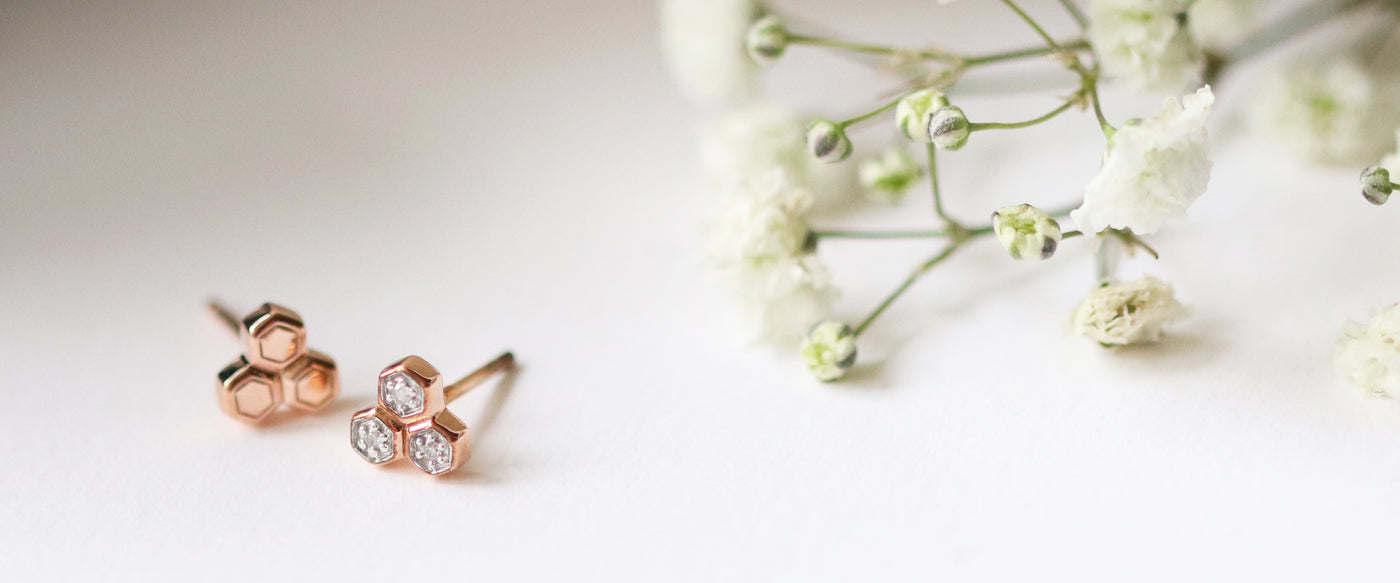 Diamond mismatched stud earrings in 9ct rose gold