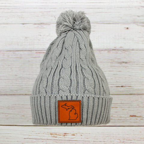 Leather Patch Cable Knit Pom Beanie