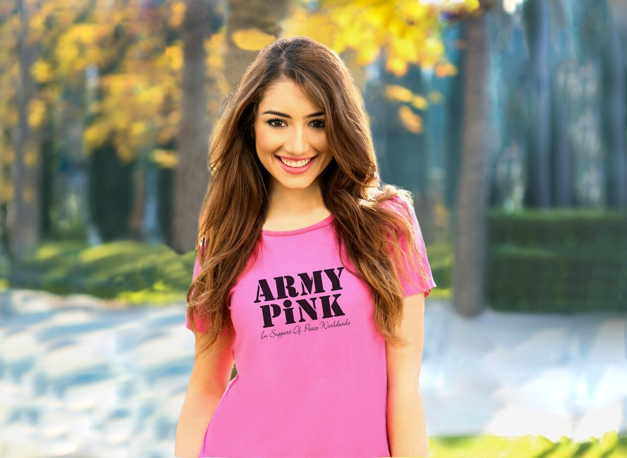 An Army Pink T-shirt Saying 'Army Pink In Support Of Peace Worldwide' being worn by a woman