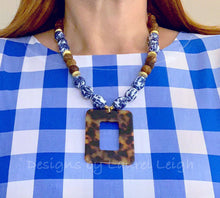 Load image into Gallery viewer, Blue and White Chinoiserie Vintage Bead Statement Necklace w/ Tortoise Shell Pendant - Designs by Laurel Leigh