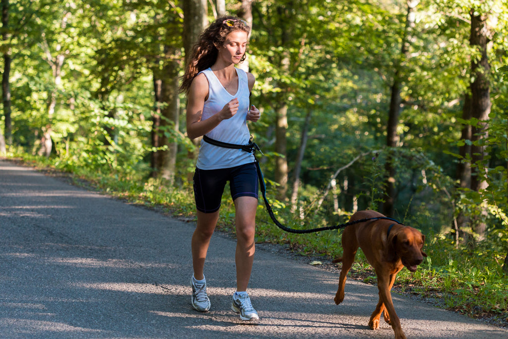 girl_running_with_dog