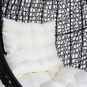 This is a product image of Black Cocoon Swing Chair White Cushion. It can be used as an Outdoor Furniture.