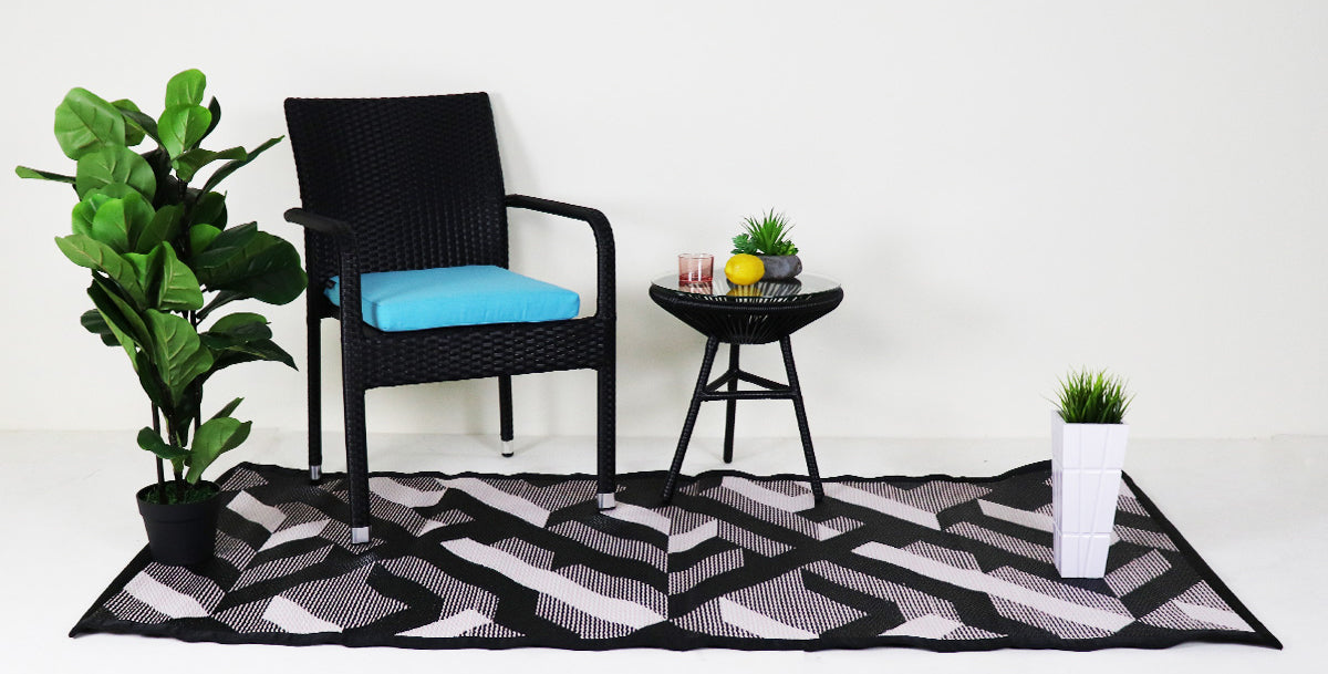 Outdoor patio chair in blue cushion with a coffee table