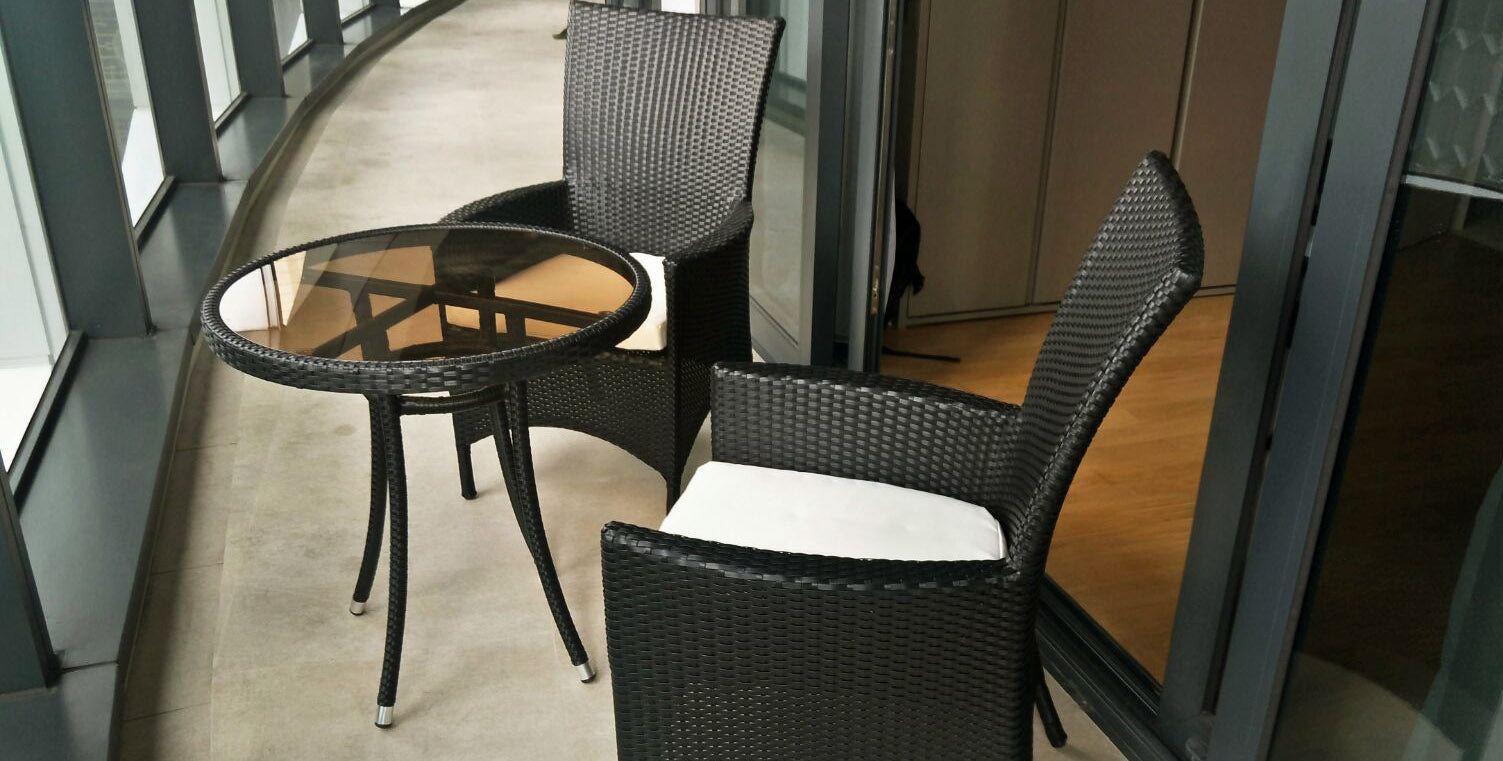 condo balcony with rattan furniture