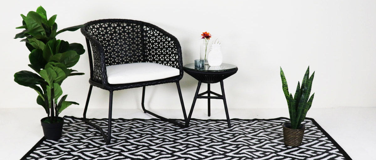 black rattan armchair and coffee table for outdoor