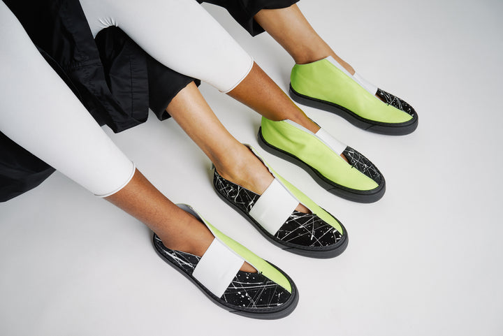 unisex sneaker with neon and black painted leather