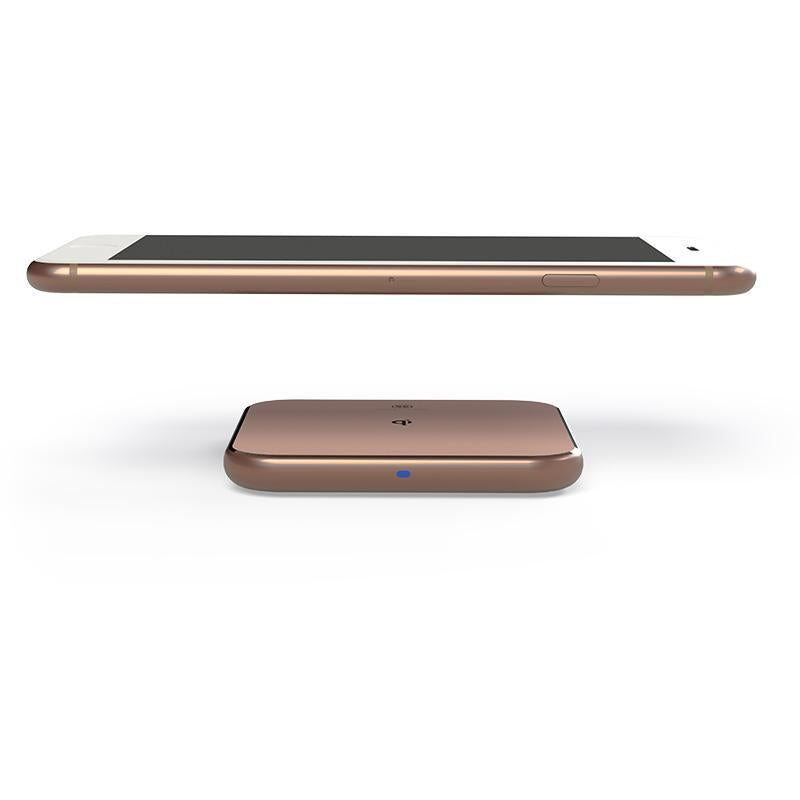 Phone hovering over Wireless charger ChargePad in rose gold