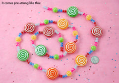 Fake Candy - 28mm Plastic Candy Christmas Garland - Sugar Coated Swirly Peppermint Plastic Beads - 1 strand