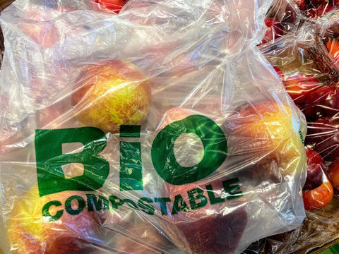 bio - compostable bag holding red gala apples. lots of apples.