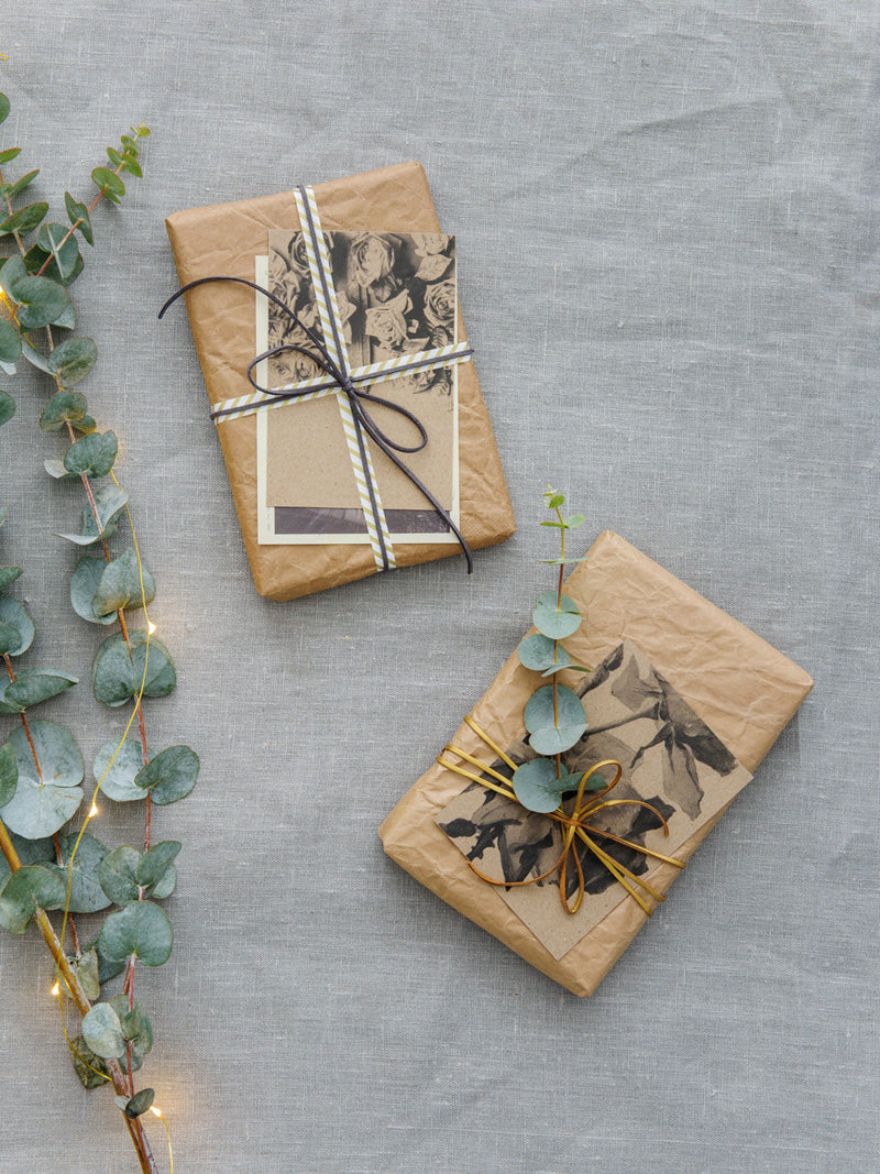 Brown paper parcels with vintage postcards