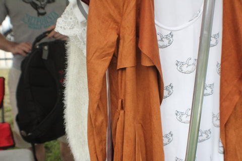 the good cat dress and our brown suede trench coat on the clothing rack
