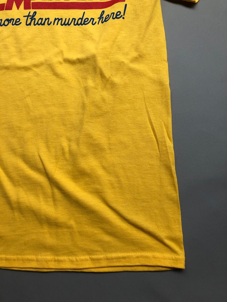 Yellow 'More than Murder' shirts by the Rat Czar