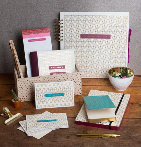 geometric design office set including note pads, folders, holders, paper, calendars part of a stationery box subscription