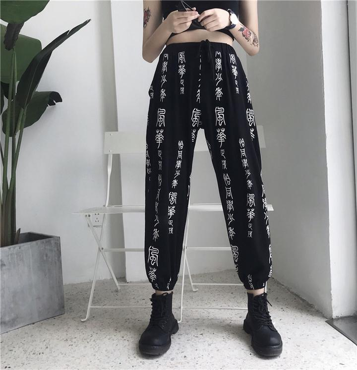 Black straight leg pants writing on them  (2108075573297)