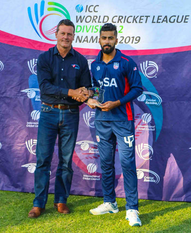 <p><em>Ali Khan accepts the Man of the Match award for his career-best 5 for 46, Namibia v USA, WCL Division Two