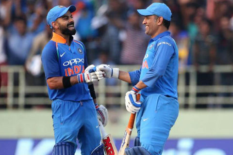 Dhoni and Kohli sharing a laugh on the pitch