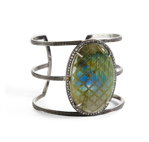 "Front view of HARPER HALLAM • ""Cross Your Fingers"" Quilted Labradorite & Diamond Cuff. You might not need to cross your fingers for luck if you have this stunning Labradorite in a Criss Cross Pattern & Diamond Pave Open Cuff on your wrist. This selection is for a Labradorite Criss Cross & Diamond Pave Open Cuff that is part of the Exes and Ohs Collection. The center stone is a large labradorite."