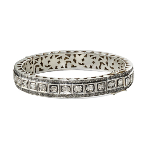 "Front view of HARPER HALLAM • ""BFFs Forever"" Diamond Polki Bangle. If this bangle was a person, you would totally go out and buy matching necklaces together because it always be by your side! Seriously. From running around town with stackables or on its own with LBD! BFFs forever. This selection is for a polki diamond bangle with diamond pave edging from the Exes and Ohs Collection."