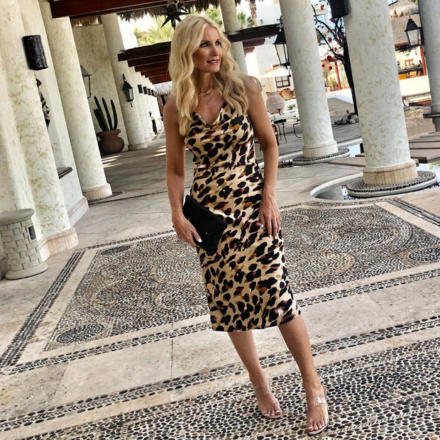 "Heather Anderson of @soheatherblog (So Heather Blog) wearing a ""Every Woman"" Leopard Midi Dress by Harper Hallam in Las Ventanas Cabo Mexico.. https://soheather.com/"