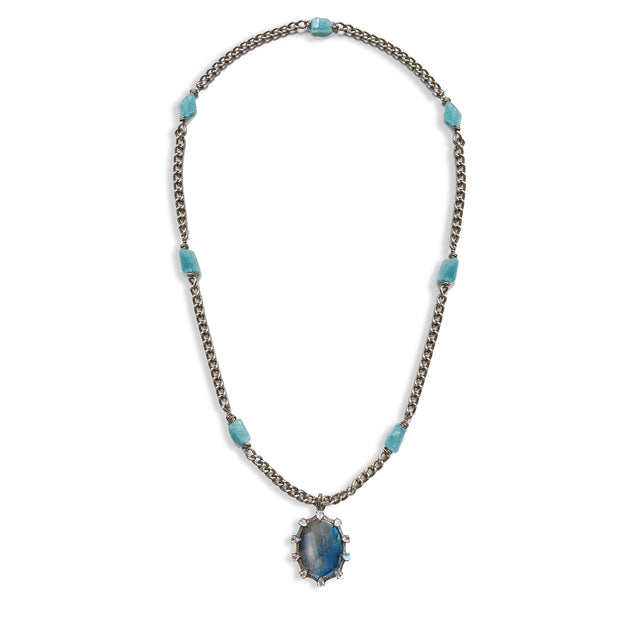 "Front view of HARPER HALLAM || ""Islands in the Stream"" Labradorite & Diamond Necklace. This selection by Harper Hallam is for a remarkable blue labradorite pendant, surrounded by white topaz and diamonds.  The chain consists of gunmetal and raw aquamarine details.  The approximate length of the necklace is 20 inches.  The approximate size of the oval pendant is 2 inches from top to bottom."