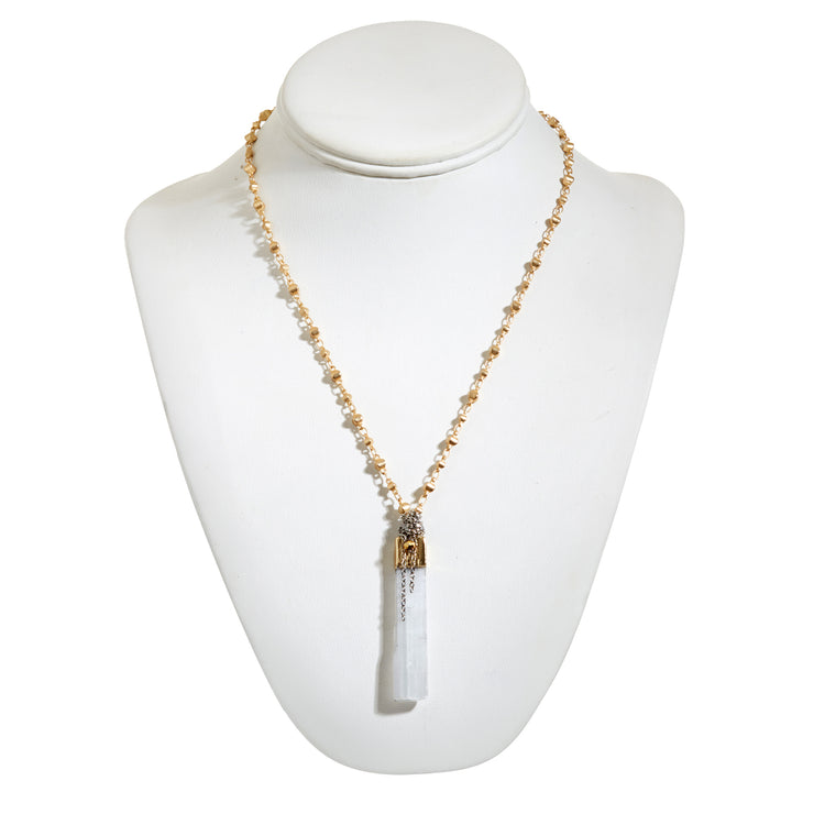 "HARPER HALLAM • ""Go Your Own Way"" with Selenite Crystal on Yellow Gold. Trust your gut, girl, and do your own thing with Selenite's shimmering beauty and it's ability to give the gift of intuition! This selection by Harper Hallam is for a necklace featuring a matte gold rosary chain with vertical selenite bar and drop chains. The length is approximately 17-20 inches with the selenite measuring 1.5-2 inches"