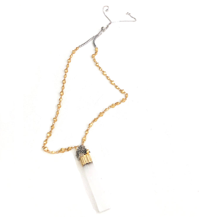 Trust your gut, girl, and do your own thing with Selenite's shimmering beauty and it's ability to give the gift of intuition! This selection by Harper Hallam is for a necklace featuring a matte gold rosary chain with vertical selenite bar and drop chains. The length is approximately 17-20 inches with the Selenite measuring 1.5-2 inches