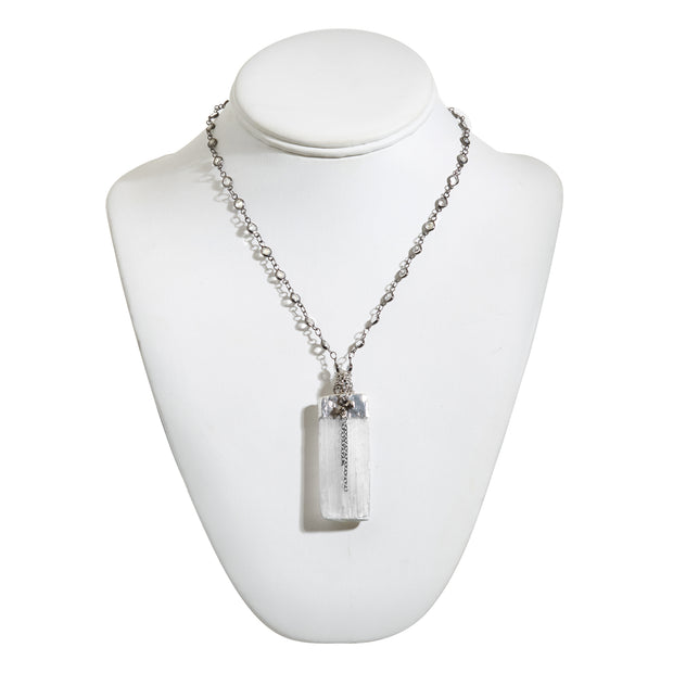 "HARPER HALLAM • ""Go Your Own Way"" Selenite Crystal Necklace in Silver. Trust your gut, girl, and do your own thing with Selenite's shimmering beauty and it's ability to give the gift of intuition! This selection is for a necklace featuring a Black Crystal Beaded Necklace with Vertical Selenite Bar and Drop Chains. The length is approximately 17-20 inches with the Selenite measuring 1.5-2"