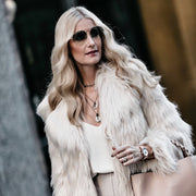 Heather Anderson of So Heather Blog wearing a piece she designed for Harper Hallam.  Here she is pictured in a fur coat on a city street of Dallas. Layered Two Coin Necklace. https://soheather.com/