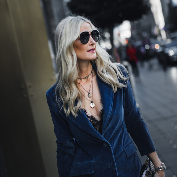 Heather Anderson of So Heather Blog wearing a piece she designed for Harper Hallam.  Here she is pictured in a blazer on a city street of Dallas. Layered Two Coin Necklace. https://soheather.com/