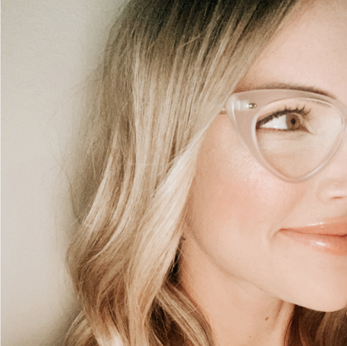 LONG HAIR BLONDE WOMAN WEARING PEARL COLOR CADDIS NEPETALACTONE EYEGLASS READERS THAT LOOK VINTAGE AND CAT EYES