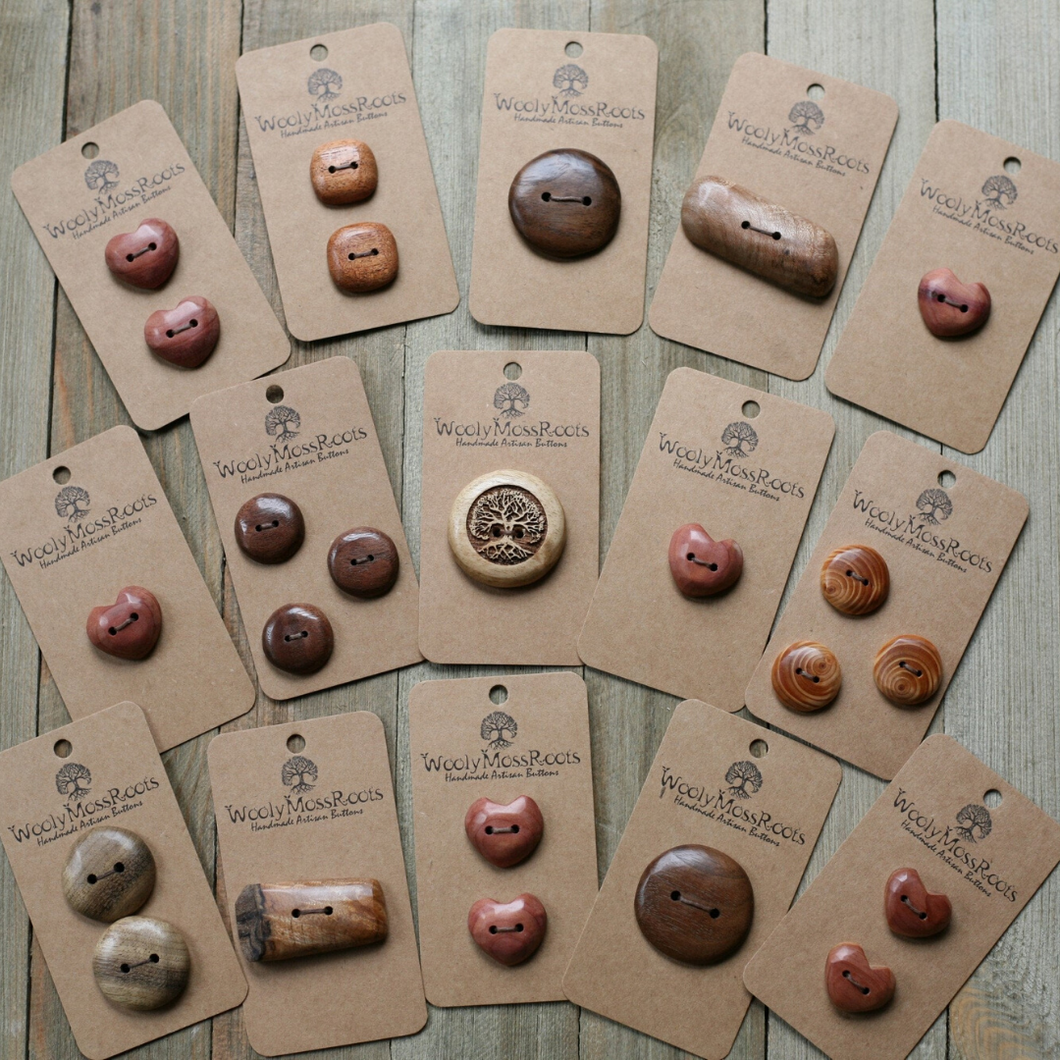 A PHOTO OF MANY HANDCRAFTED BUTTONS MADE OF VARIOUS WOODS  OF DIFFERENT SHAPES AND QUANTITIES