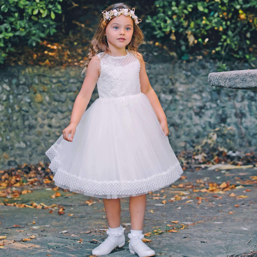 Girl in a garden wearing Ivory Phoebe - Ribbons and Lace Dress from U Flower Girl Boutique