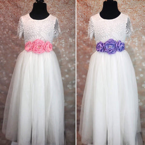 White dresses with pink and purple sash corsages