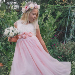 girl in pink party dress with bouquet
