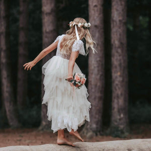 Girl dancing on log in forest