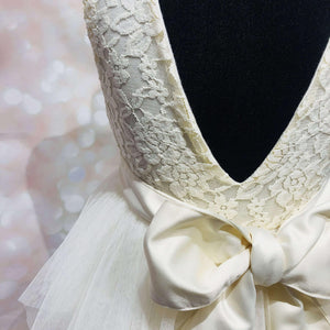 bow on back of ivory party dress